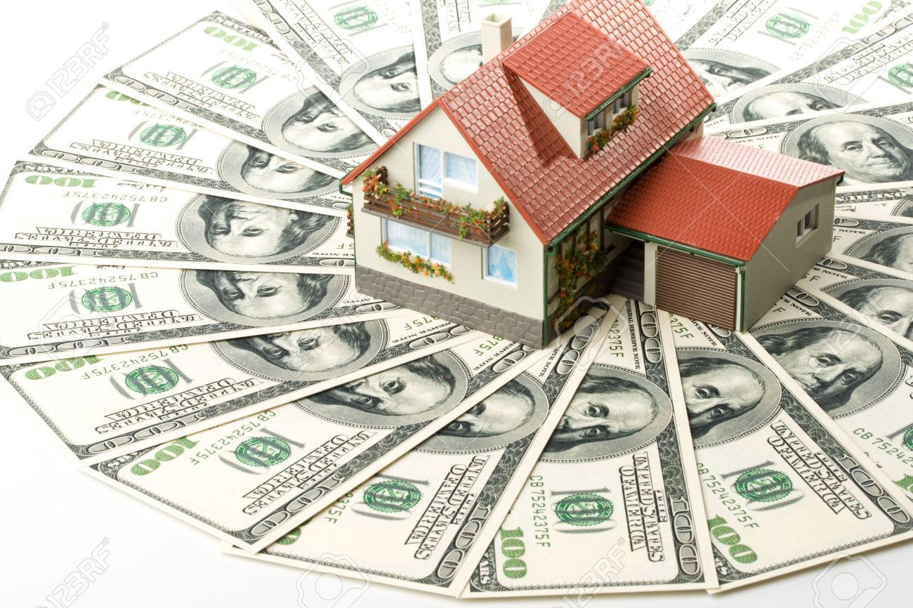 3360761-Miniature-House-and-Money-Buying-house-concept-Stock-Photo